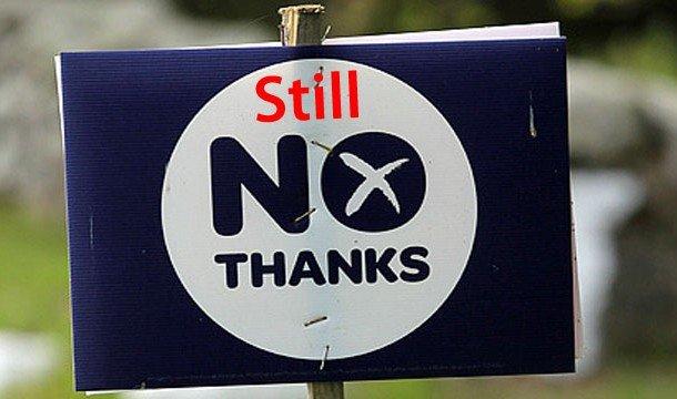 Надпись на табличке: Still NO thanks