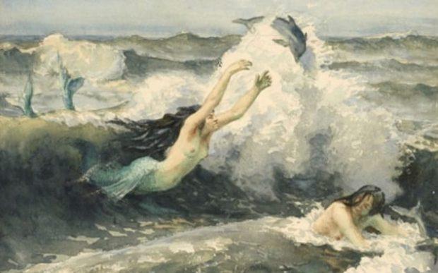Русалки и дельфины в волнах